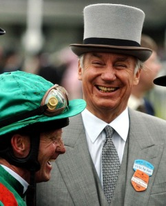 Ismaili spiritual leader, Karim Aga Khan, right, shows his delight with jockey Mick Kinane, left, after his horse Azamour won the Prince of Wales Stakes during the second day of Royal Ascot at York racecourse, York, England, Wednesday June 15, 2005. (AP Photo/John Giles/PA)