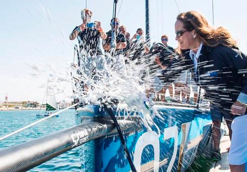Princess Zahra Aga Khan baptises her new yacht Azzurra by breaking a bottle of champagne Dom Perignon on Azzurra's bow (Credit: 52 Super Series 2015, Martinez Studio/52 Super Series)