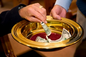 Photo of a tithe collection plate in a church used as a 'mehmani' collection bowl in Ismaili Jamatkahanas.